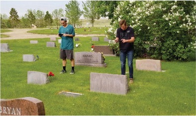 Visiting Missionaries In Wolf Point  Photographing Cemetery Headstones