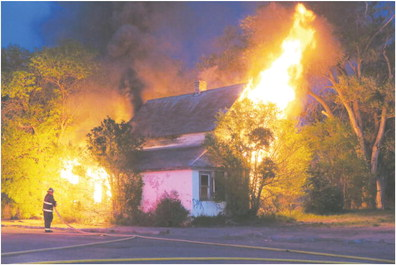 Fire Destroys House On Front Street