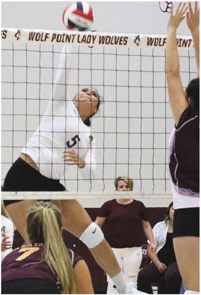 Lady Wolves Score Volleyball Victory Over Baker Squad